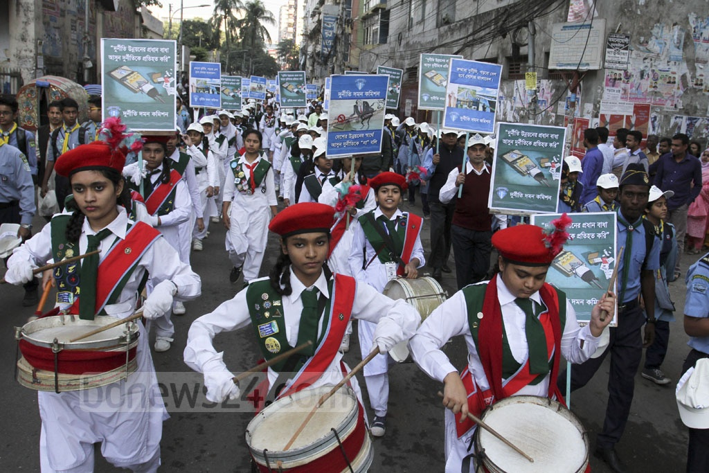 The Anti-Corruption Commission holds a rally in front of its main offices in Dhaka's Shegun Bagicha on Sunday, International Anti-Corruption Day. Photo: Asif Mahmud Ove