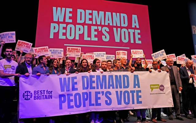 Pro-EU supporters take to the stage at a joint political rally by Best for Britain and the People's Vote campaign in London, Britain, Dec 9, 2018. REUTERS