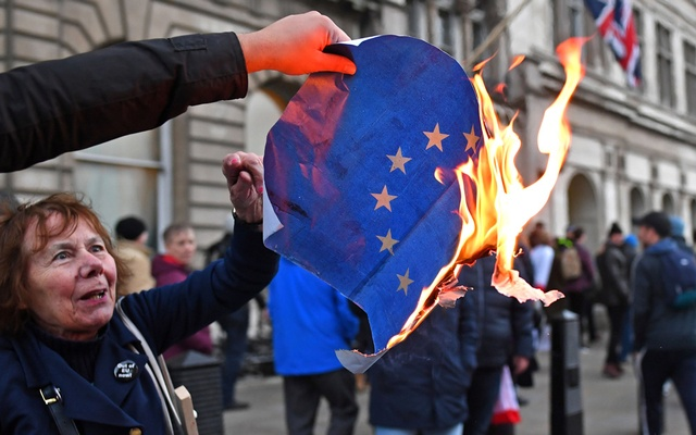 Pro-Brexit supporters burn an EU flag during a UKIP demonstration in central London, Britain, Dec 9, 2018. REUTERS