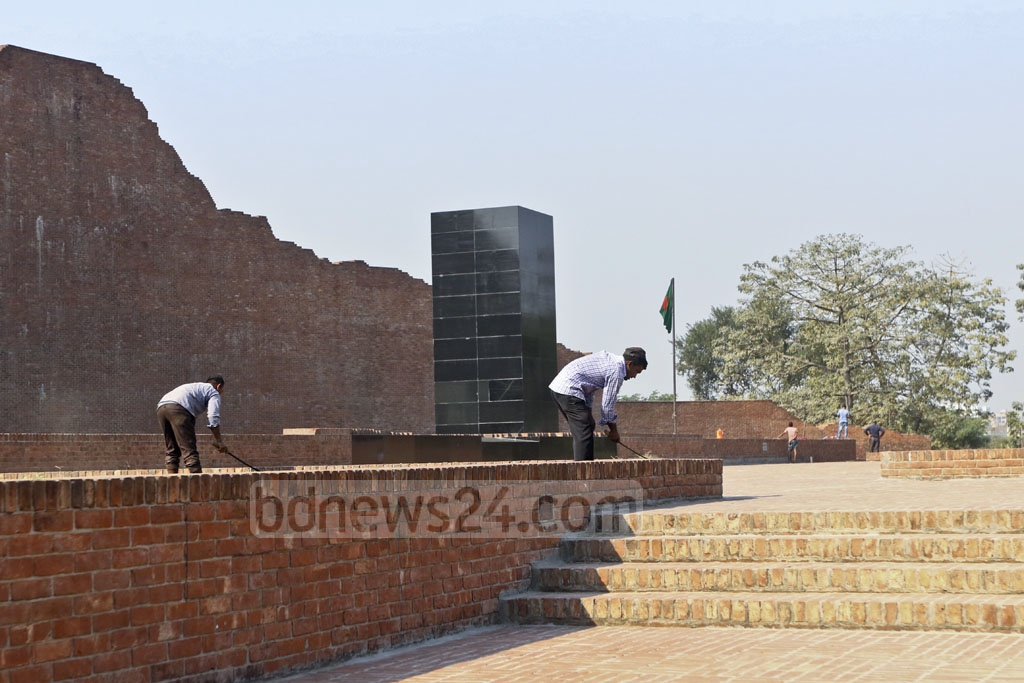 The Rayer Bazar memorial being cleaned up on Monday ahead of the Martyred Intellectuals Day. Photo: Abdullah Al Momin