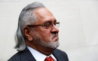 Vijay Mallya has a break outside the court house as he waits for his extradition case to be heard at Westminster Magistrates Court, in London, Britain, Dec 10, 2018. REUTERS/Peter Nicholls