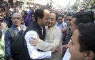 BNP leader Abdullah Al Noman exchanging greetings with Awami League candidate Mohibul Hasan Chowdhury Nowfel during their election campaign at the port city of Chattogram on Tuesday.