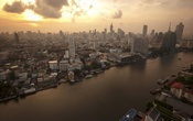 The skyline of central Bangkok and the Chao Phraya river are seen during sunrise in Bangkok Apr 22, 2015. REUTERS