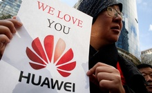 Lisa Duan, a visitor from China, holds a sign in support of Huawei outside of the BC Supreme Court bail hearing of Huawei CFO Meng Wanzhou, who is being held on an extradition warrant in Vancouver, British Columbia, Canada Dec 10, 2018. REUTERS
