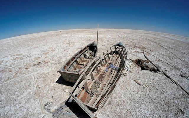 FILE PHOTO: Boats are seen on the dried lake Poopo affected by climate change, in the Oruro Department, Bolivia, September 1, 2017. REUTERS/David Mercado