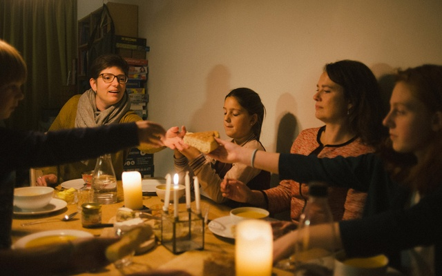 Pastors Jessa van der Vaart, second from right, and Rosaliene Israel, left, the secretary general of Protestant Church Amsterdam, during a meal in Amsterdam before going to Bethel Church at The Hague for a continuous service, on Dec. 5, 2018. Pastors have sheltered a family of refugees by praying round the clock for six weeks — taking advantage of an obscure Dutch law and experimenting with their sermons. (Dmitry Kostyukov/The New York Times)