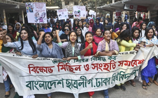 Members of Bangladesh Chhatra League take out a procession on the Dhaka University campus on Wednesday demanding war criminals and their patrons be banned from the parliamentary elections. Photo: Abdullah Al Momin