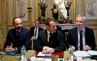 President Emmanuel Macron of France, Prime Minister Édouard Philippe, left, and Bruno Le Maire, the finance minister, meet with bankers at the Elysee Palace in Paris, Dec 11, 2018. The New York Times