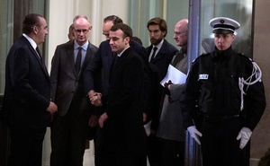 French President Emmanuel Macron (C) leaves an emergency meeting at the Interior Ministry in Paris, France, late 11 Dec 2018