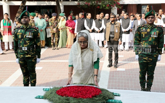 Prime Minister Sheikh Hasina placing a wreath at the grave of the Father of the Nation Bangabandhu Sheikh Mujibur Rahman at Tungiparha before formally kicking off election campaign in the Gopalganj-3 constituency on Wednesday. Photo: Saiful Islam Kallol