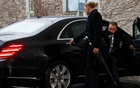 Staff member opens a car door for British Prime Minister Theresa May as she arrives at the Chancellery in Berlin, Germany December 11, 2018. Reuters