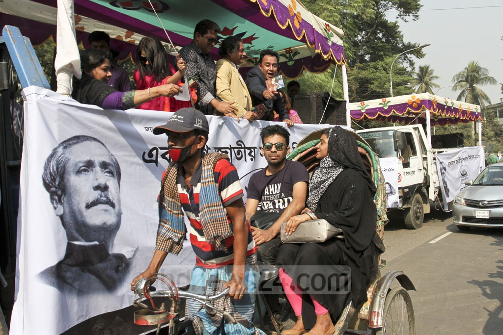 Scores of celebrities distributing leaflets during the ruling Awami League's election campaign at the Central Shaheed Minar in Dhaka on Thursday. Photo: Asif Mahmud Ove