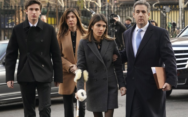 Michael Cohen, right, the former lawyer for President Donald Trump, walks with family members to federal court in Manhattan, Dec 12, 2018. Cohen is to be sentenced on Wednesday for his role in a hush-money scandal that could threaten Trump's presidency by implicating him in a scheme to buy the silence of two women who said they had affairs with him. (Chang W. Lee/The New York Times)
