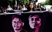 People march to show solidarity for jailed Reuters journalists Wa Lone and Kyaw Soe Oo two days before a local court is due to deliver verdict against them on charges of breaching the country's Official Secrets Act in Yangon, Myanmar, September 1, 2018. REUTERS/Ann Wang