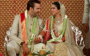 Bride Isha Ambani, the daughter of the Chairman of Reliance Industries Mukesh Ambani, and her groom Anand Piramal, heir to a real-estate and pharmaceutical business, after they got married in Mumbai, India, December 12, 2018. Reliance Industries/Handout via REUTERS