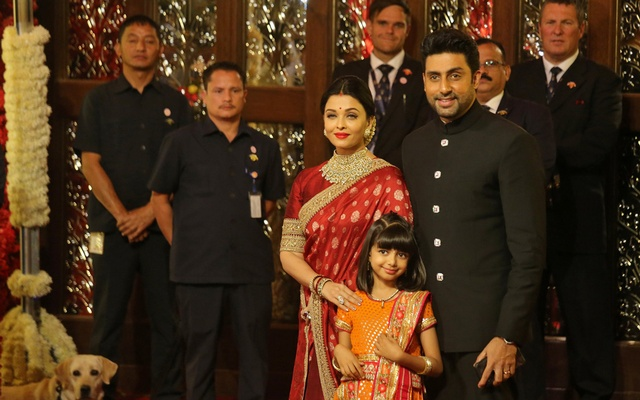 Actor Abhishek Bachchan, his wife actress Aishwarya Rai and their daughter Aaradhya arrive to attend the wedding ceremony of Isha Ambani, the daughter of the Chairman of Reliance Industries Mukesh Ambani, in Mumbai, India, December 12, 2018. Reuters