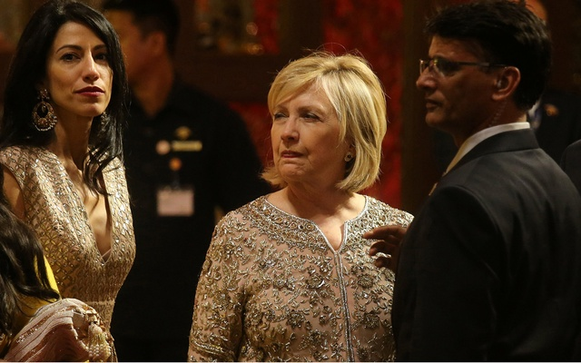 Former US Secretary of State Hillary Clinton waits for her car after attending the wedding ceremony of Isha Ambani, the daughter of the Chairman of Reliance Industries Mukesh Ambani, at their residence in Mumbai, India, December 12, 2018. Reuters