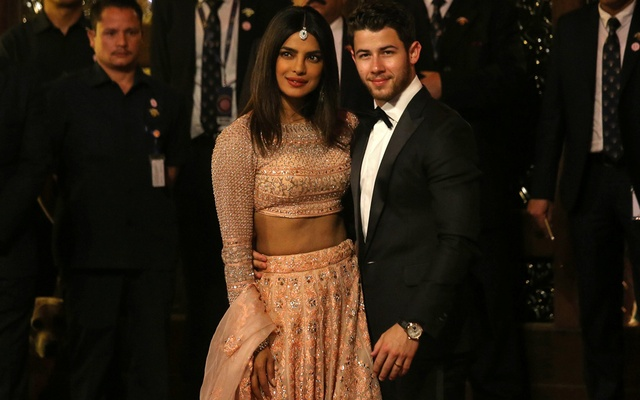 Actress Priyanka Chopra and her husband Nick Jonas arrive to attend the wedding ceremony of Isha Ambani, the daughter of the Chairman of Reliance Industries Mukesh Ambani, in Mumbai, India, December 12, 2018. Reuters