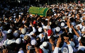 FILE PHOTO - Supporters carry the coffin of Ko Ni, a prominent member of Myanmar's Muslim minority and legal adviser for Myanmar's ruling National League for Democracy, after he was shot dead, in Yangon, Myanmar January 30, 2017. Reuters