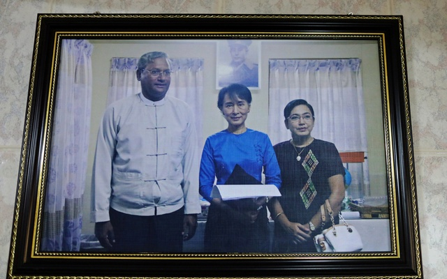 A picture of Ko Ni and Aung San Suu Kyi hangs on a wall of Ko Ni's home office at his house in Yangon, Myanmar, October 4, 2018. Reuters