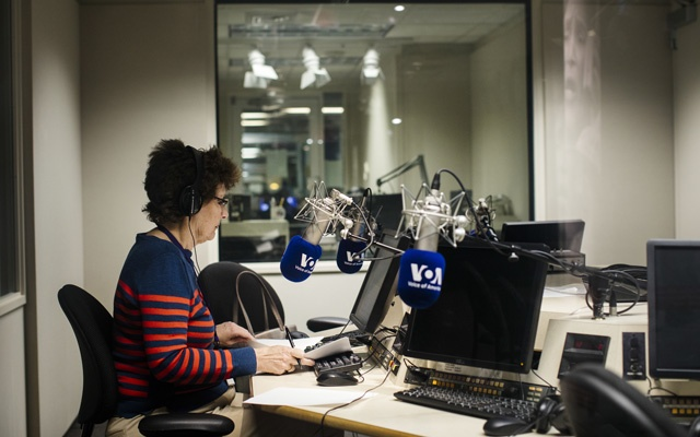 Faith Lapidus prepares for a radio broadcast at the Voice of America studio, in Washington, Dec 3, 2018. The agency that oversees Voice of America and other government broadcasting has endured a series of recent scandals. Soon a Trump appointee will take over. The New York Times
