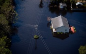 FILE -- Flooded homes, roads and fields after Hurricane Florence, in Elizabeth City, N.C., Sept. 18, 2018. More records for both wet and dry weather are being set around the globe, according to a study published in December 2018. (Hilary Swift/The New York Times)