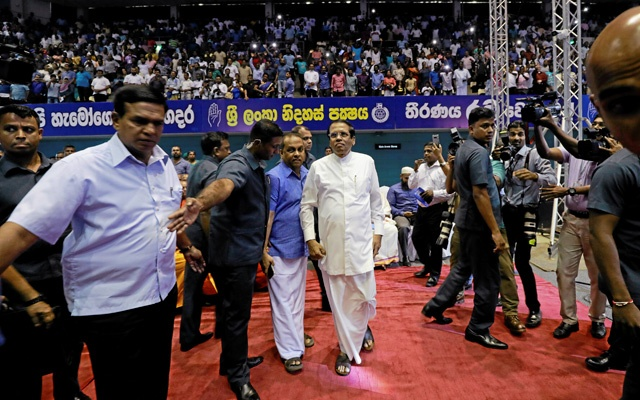 Sri Lanka's President Maithripala Sirisena (C) is escorted by President's Security Division officers as he arrives at a special party convention in Colombo, Sri Lanka Dec 4, 2018. REUTERS