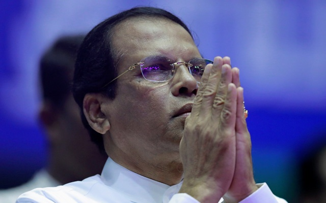 Sri Lanka's President Maithripala Sirisena prays during a special party convention in Colombo, Sri Lanka Dec 4, 2018. REUTERS