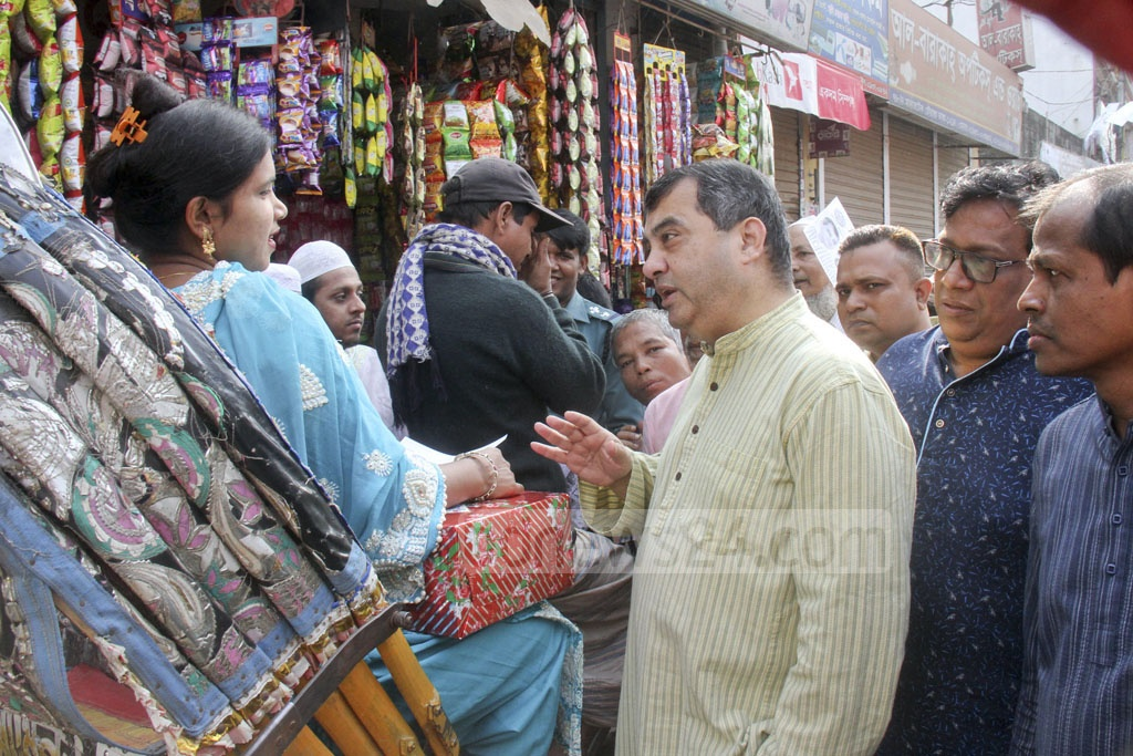 The Awami League's candidate for Dhaka-9 Saber Hossain Chowdhury campaigning at Basabo on Friday ahead of the election.