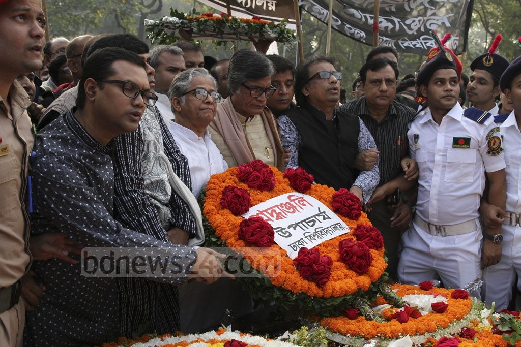 Dhaka University VC Prof Md Akhtaruzzaman pays tribute to the martyred intellectuals at the Martyred Intellectuals Memorial at Mirpur in Dhaka on Friday. Photo: Asif Mahmud Ove