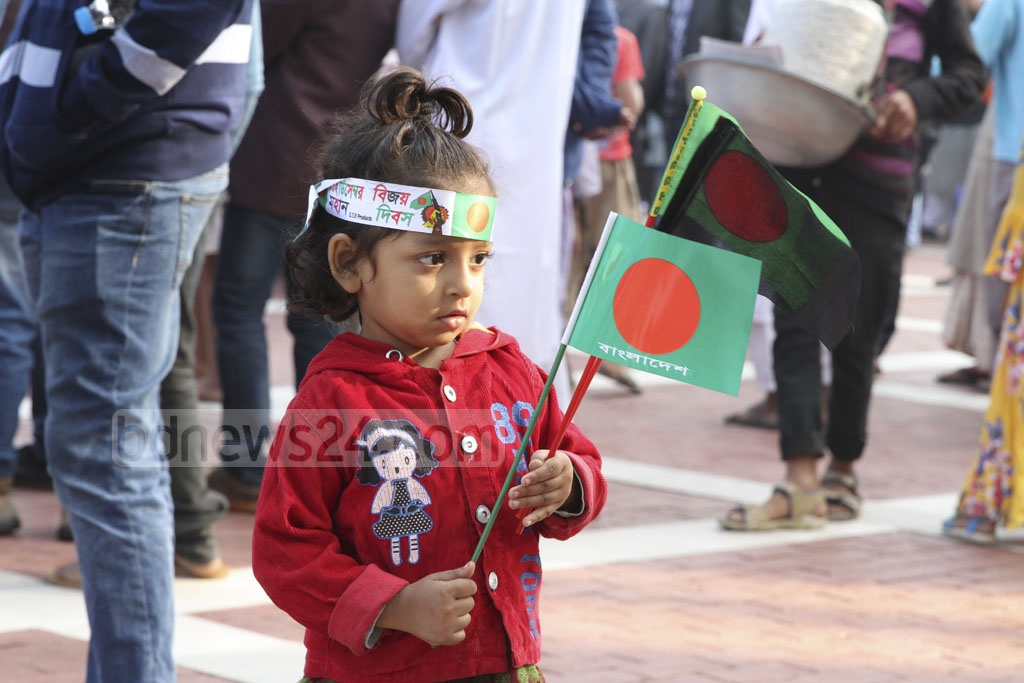 A child at the Rayerbazar Martyred Intellectuals Memorial at Mirpur in Dhaka on Friday. Photo: Asif Mahmud Ove