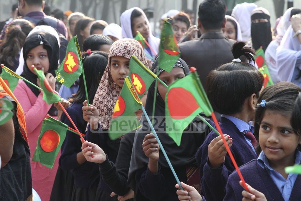 Students from different educational institutes pay tribute to the martyred intellectuals at the Martyred Intellectuals Memorial at Mirpur in Dhaka on Friday. Photo: Asif Mahmud Ove