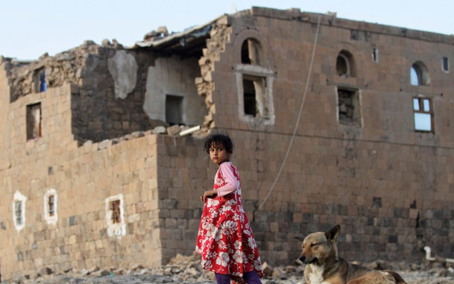 A girl walks near her house destroyed in an air strike carried out by the Saudi-led coalition in Faj Attan village, Sanaa, YemenDecember 13, 2018. Reuters