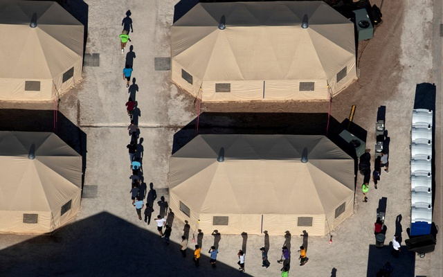 Immigrant children are led by staff in single file between tents at a detention facility next to the Mexican border in Tornillo, Texas, US, Jun 18, 2018. Reuters photographer Mike Blake: