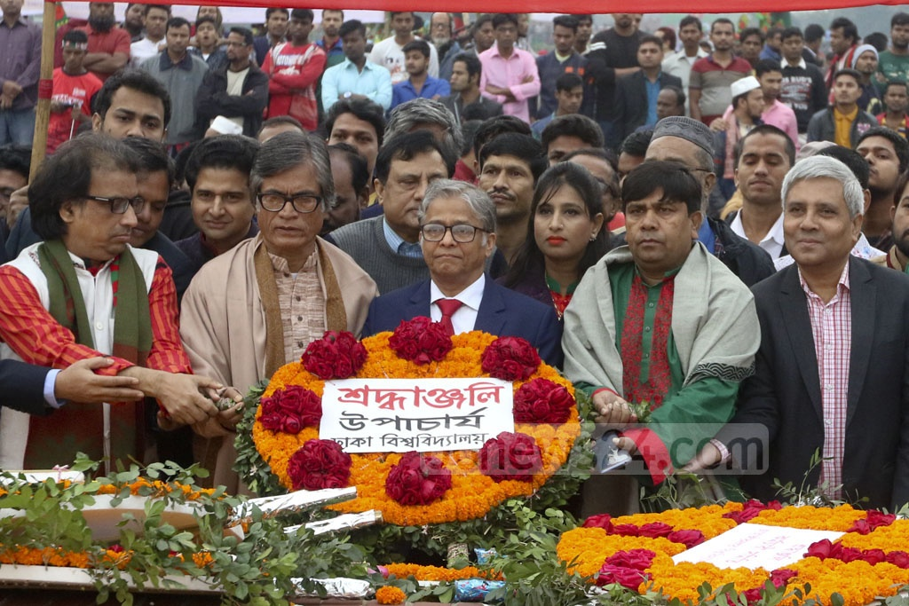 Dhaka University Vice Chancellor Md Akhtaruzzaman pay respects at the National Martyrs' Memorial on Sunday on behalf of the university. Photo: Abdullah Al Momin