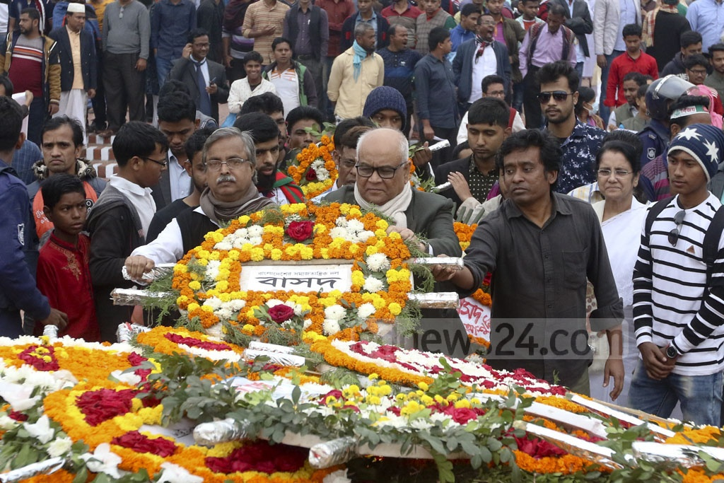The Communist Party of Bangladesh pays its respects to the martyrs of 1971 at the National Martyrs' Memorial on Sunday. Photo: Abdullah Al Momin