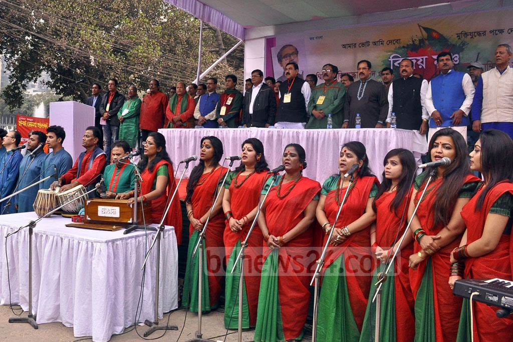 Artistes sing the national anthem at Shahbagh Square on Victory Day on Sunday
