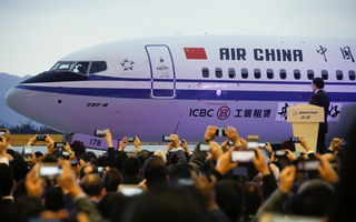 Guests attend a ceremony marking the 1st delivery of a Boeing 737 Max passenger airplane to Air China at the Boeing Zhoushan completion center in Zhoushan, Zhejiang province, China, December 15, 2018. Reuters