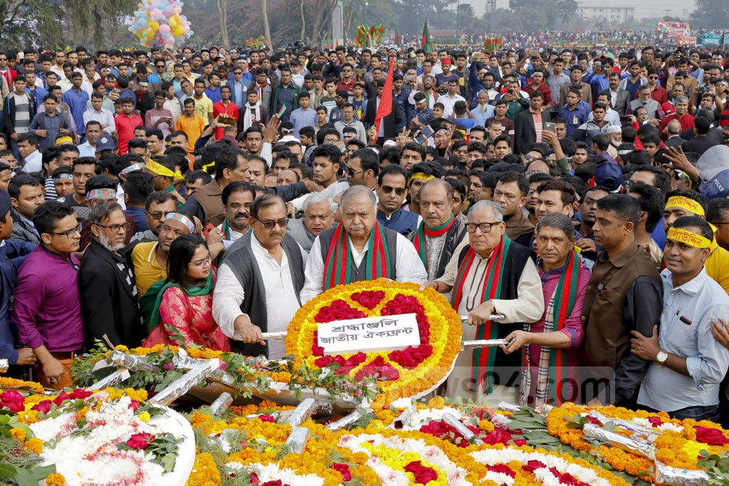 A delegation of the Jatiya Oikya Front, led by Dr Kamal Hossain, pays its respects at the National Martyrs' Memorial on Sunday. Photo: Abdullah Al Momin