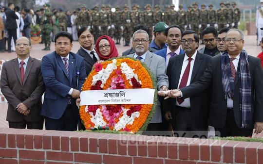 Chief Election Commissioner KM Nurul Huda at the National Martyrs' Memorial in Savar on Victory Day on Sunday. Photo: Abdullah Al Momin