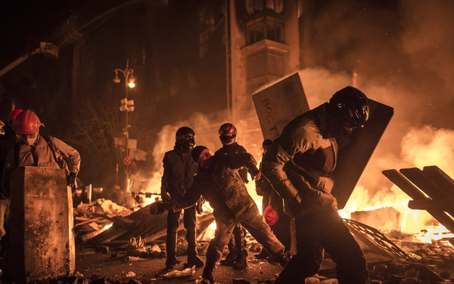 FILE -- Clashes during anti-government demonstrations in Kiev, Ukraine, Feb 19, 2014. McKinsey, the influential US-based consultancy, has for decades helped raise the stature of authoritarian and corrupt governments across the globe, including Viktor Yanukovych, the Ukrainian leader toppled by protests here. Sergey Ponomarev/The New York Times