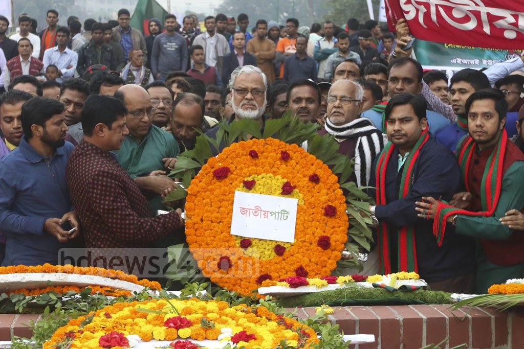 The Jatiya Party pays its respects the martyrs of 1971 at the National Martyrs' Memorial on Sunday. Photo: Abdullah Al Momin
