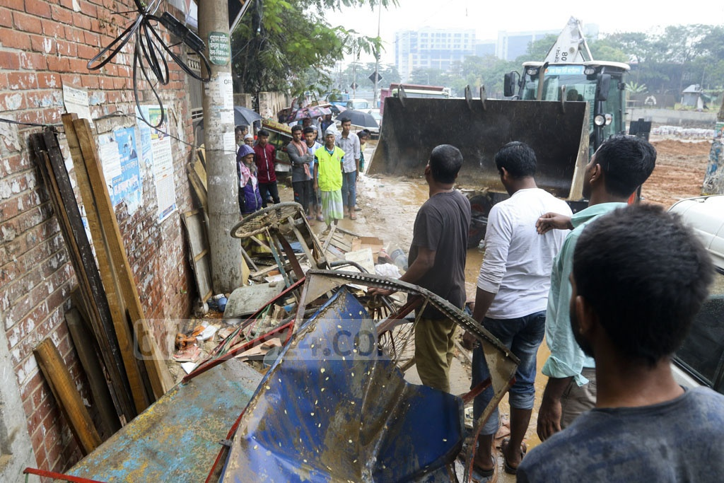 The Dhaka North City Corporation bulldozing illegal structures on pavements at Agargaon during an eviction drive on Monday. Photo: Abdullah Al Momin