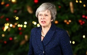 Britain's Prime Minister Theresa May speaks outside 10 Downing Street after a confidence vote by Conservative Party Members of Parliament (MPs), in London, Britain Dec 12, 2018. REUTERS/Hannah McKay