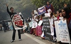 Protesters carry placards as they shout slogans during a protest to mark the first anniversary of the Delhi gang rape, in New Delhi. Thomson Reuters