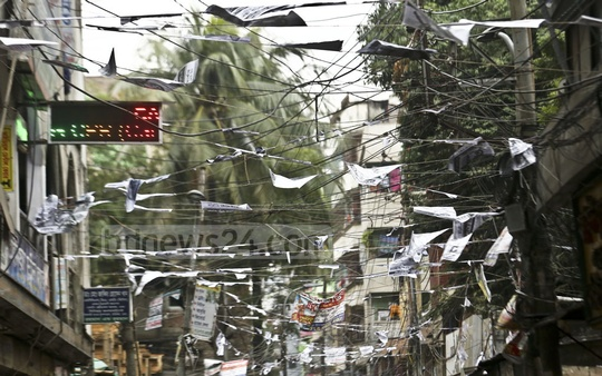 Two days of rain have ruined many of the election posters in Dhaka's Shahjahanpur area. Photo: Mahmud Zaman Ovi