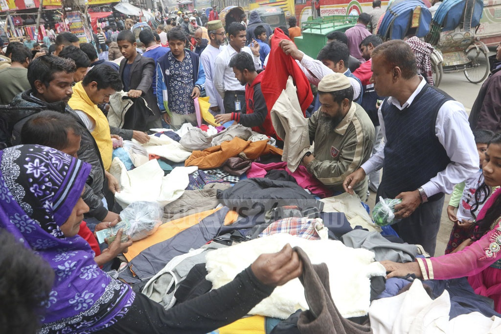 The low-income people of Dhaka are buzzing the winter clothes shops on pavements or streets as a spell of cold weather has hit the country. This photo was taken from Gulistan on Wednesday.