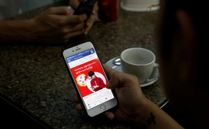 FILE PHOTO: A cellphone user looks at a Facebook page at a shop in Latha street, Yangon, Myanmar Aug 8, 2018. REUTERS