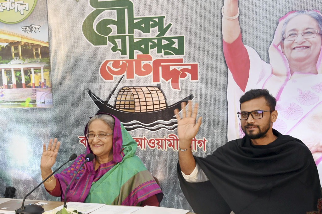 Prime Minister Sheikh Hasina addressed a campaign rally in Narail on Thursday from her Sudha Sadan residence in Dhaka via video conference. The Awami League candidate, national cricketer Mashrafe Bin Mortaza, accompanied her.
