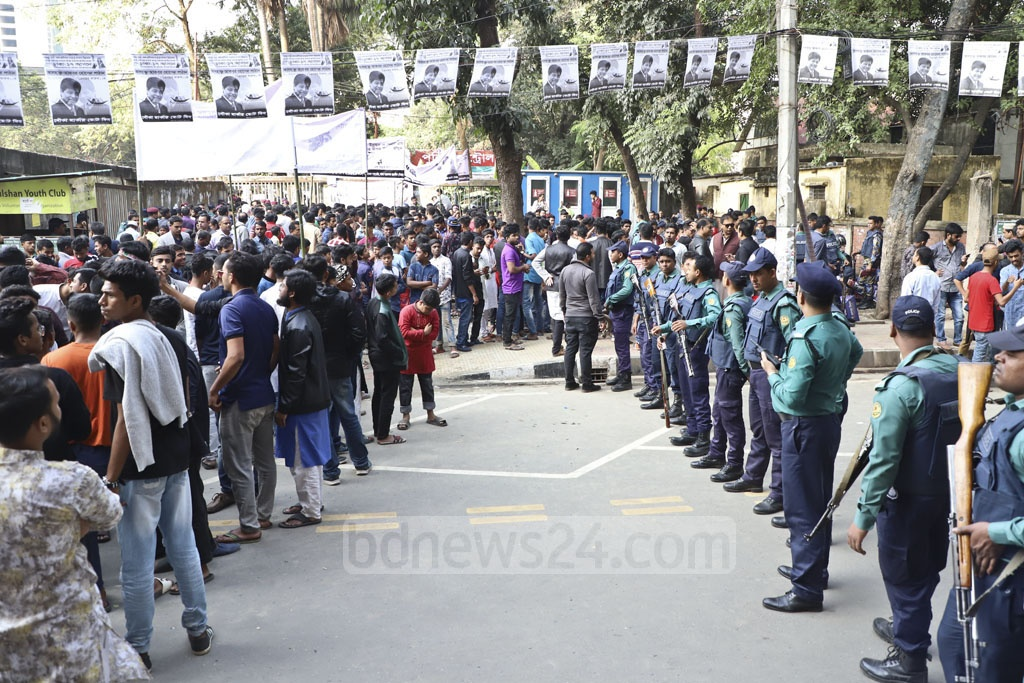 Police stand guard at a campaign rally of the ruling party at the Gulshan Youth Club ground in Dhaka on Friday. Photo: Abdullah Al Momin